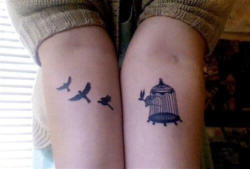 Bird With Cage Tattoo girl