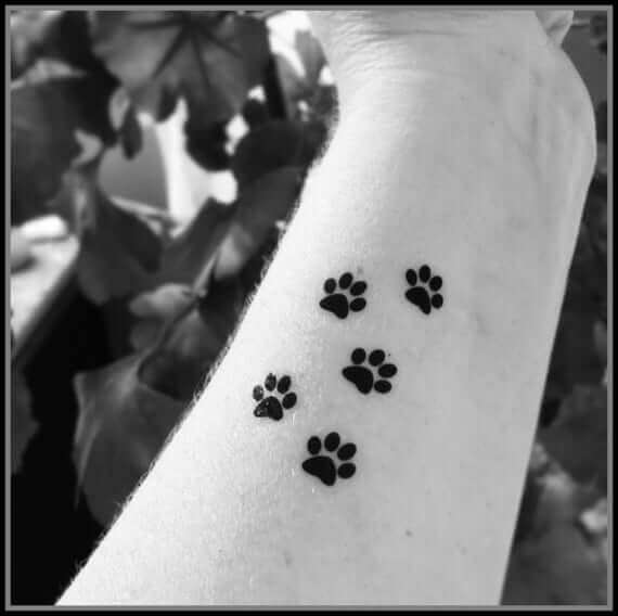 Black Paw Prints Hand Tattoos designs