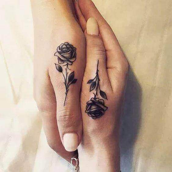 Black rose tattoo pic for couples
