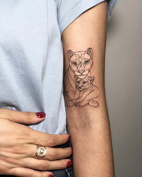Lioness with cub tattoo image