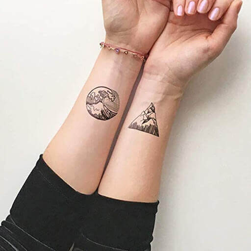 Mountain & Waves matching Tattoo on hand