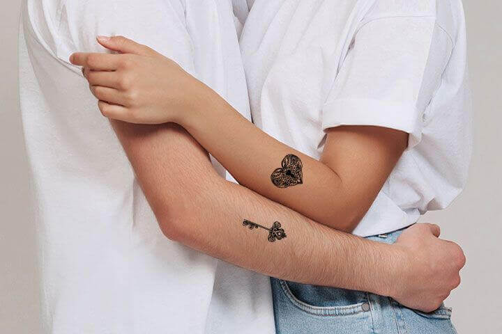 Trending Key and Lock couple tattoo