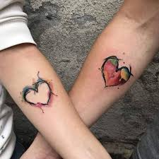 colorful heart tattoo for couple