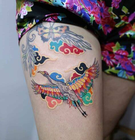 colorful tattoo girl on thigh