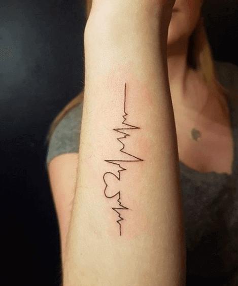 heartbeat hand tattoo girl