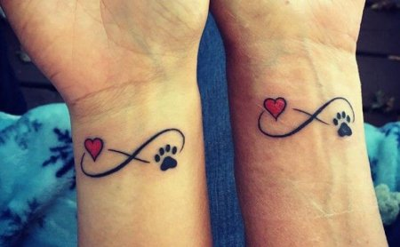 Heart with paw tattoos