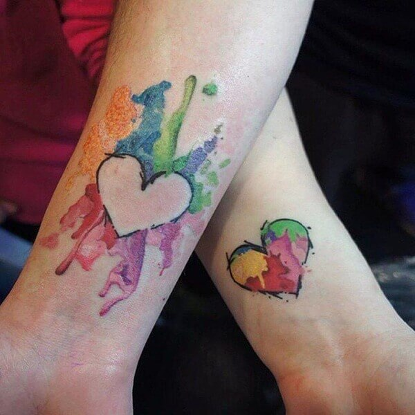 Colorful tattoo designs on hand