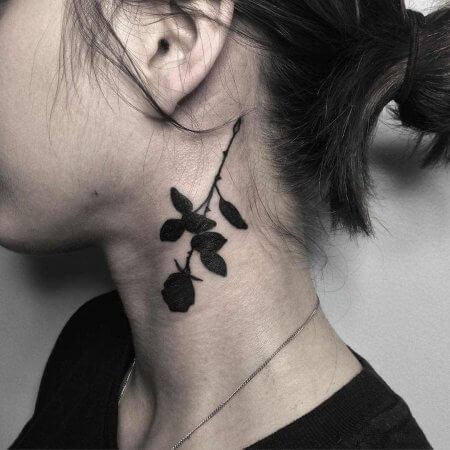 Black Rose Tattoo behind the ear