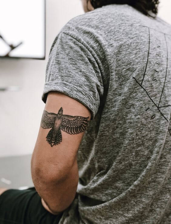 Black and Grey Bird tattoo on forearm