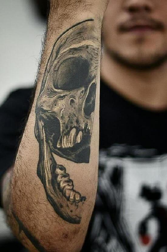 Half skull tattoo on arm fo boys