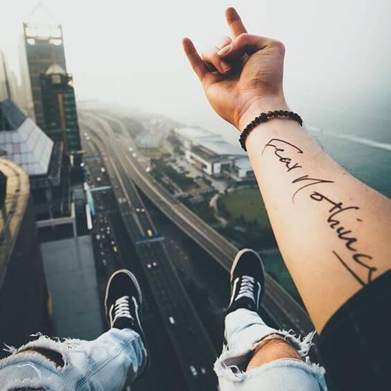 Inspiring Quote Tattoo Ideas on Boys arm