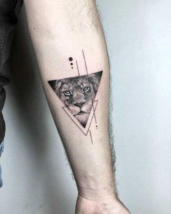 Lion tattoo in triangle on boys arm