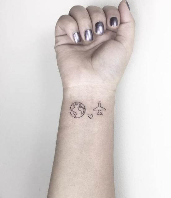 Minimalist plane and world map tattoo