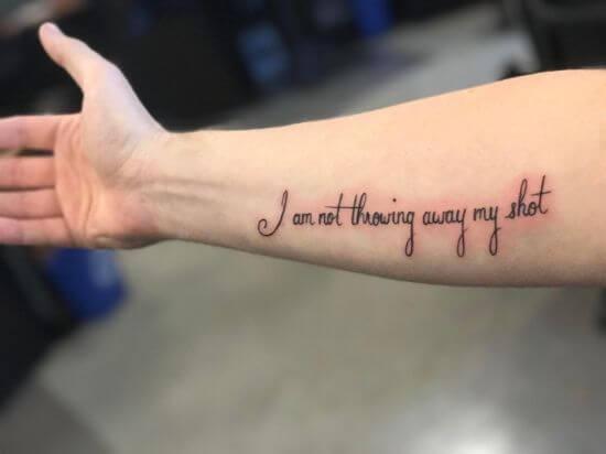 Boys tattoo on arm