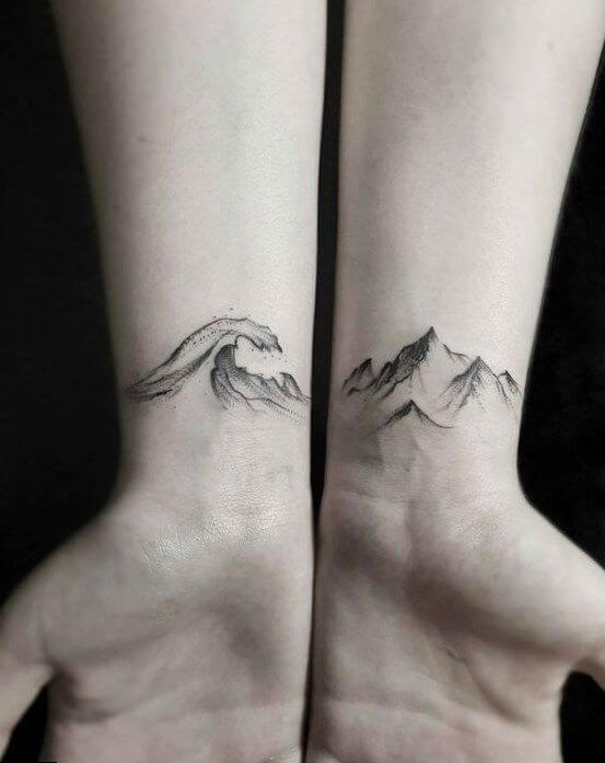 Small Mountain and wave tattoo on wrist