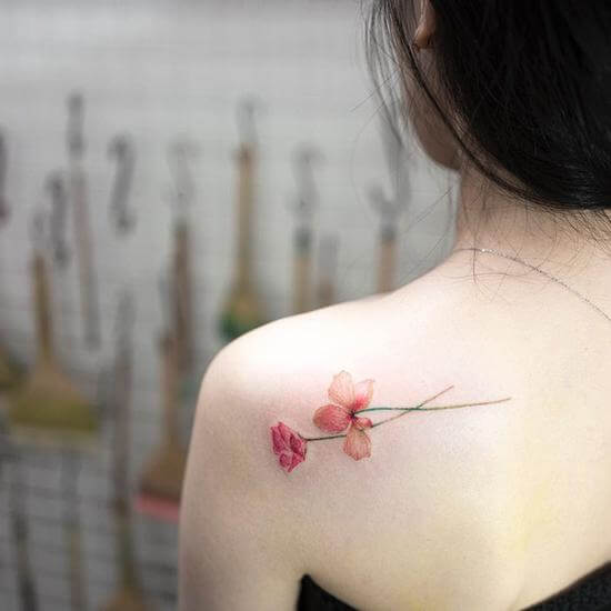 Small tatoo designs on shoulder