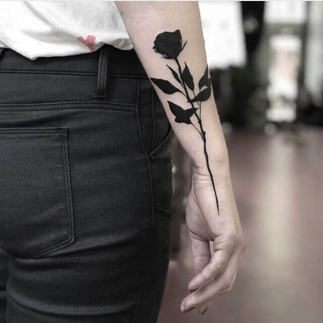 Solid Black Rose tatto on arm