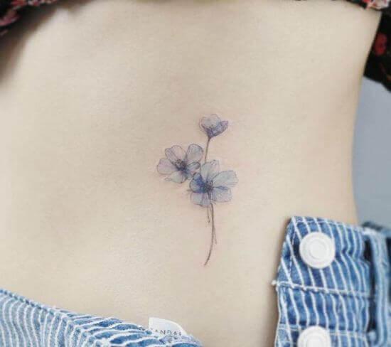 Beautiful Small Flower Tattoo Designs on Women's Rib