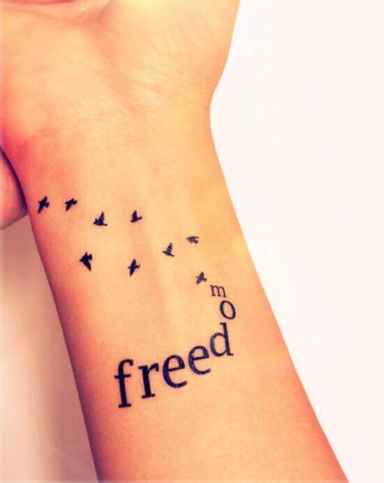 Bird With _FREEDOM_ Small Tattoo