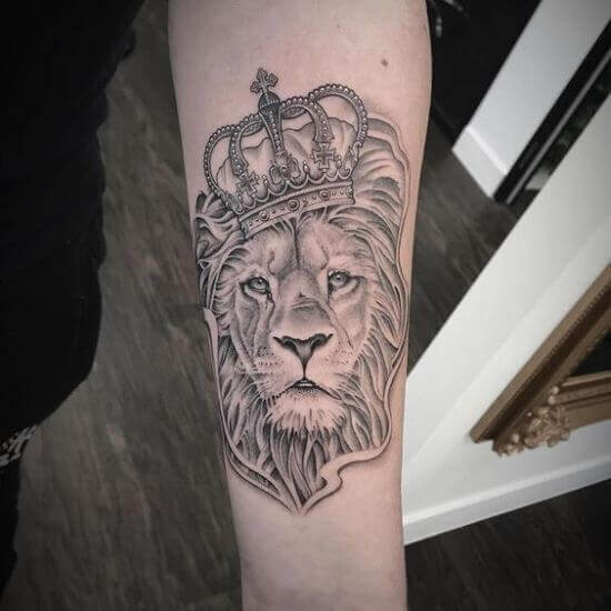 Forearm Lion with Crown tattoo