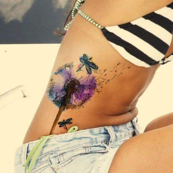 Girl Rib cage dragonflies tattoo