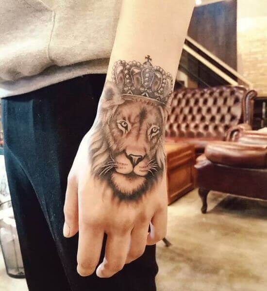 Latest Lion with Crown Tattoo designs on Hand