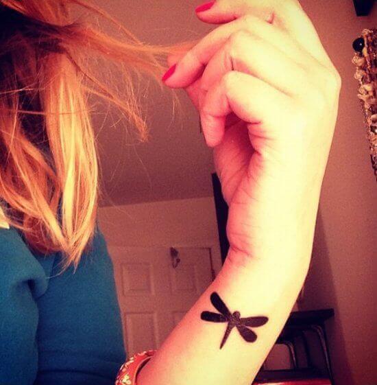 Small Black Dragonfly wrist tattoo girl