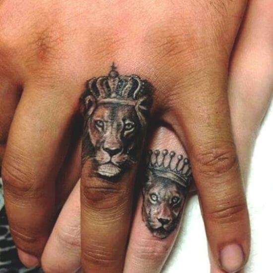 Tiny lion with crown tattoo on finger