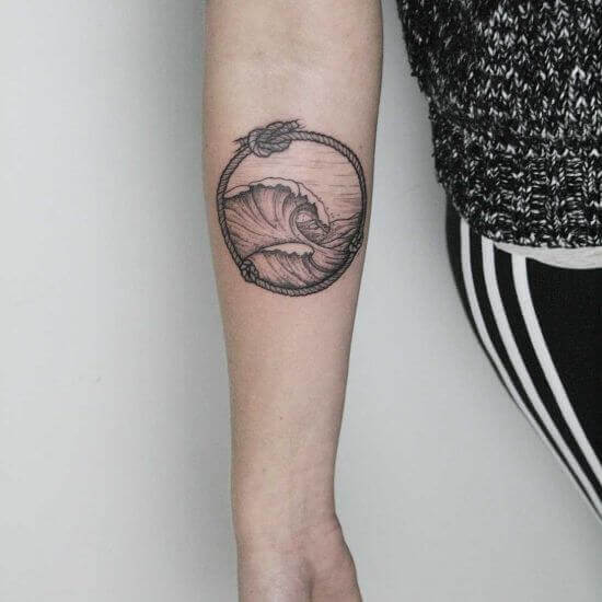 Unique wave tattoo designs on arm