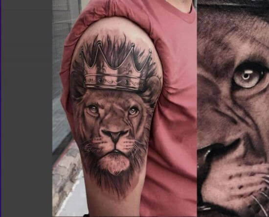 Upper arm lion with crown tattoo