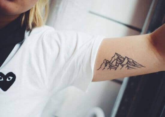 Mountain with three peaks tattoo ideas on girl arm