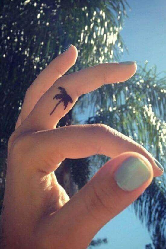 Tiny Palm tree tattoos on finger