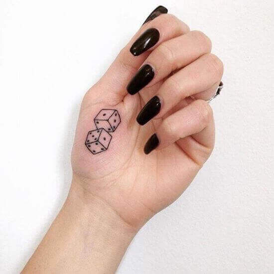 Small Hand Dice Tattoo