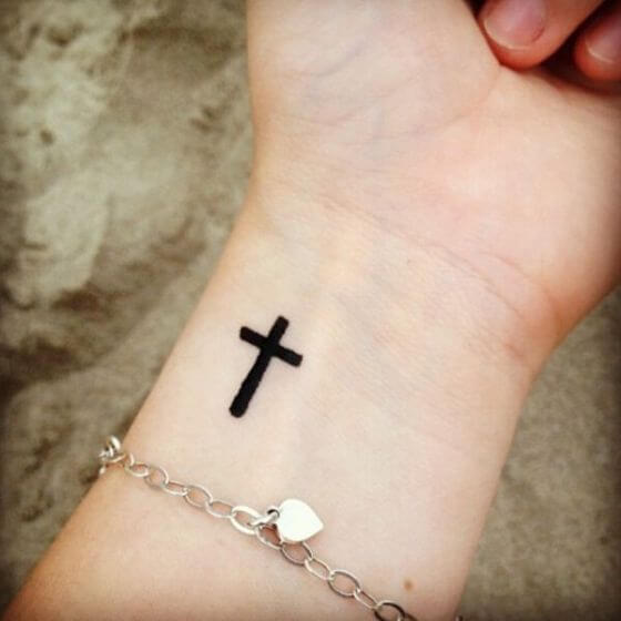 Cross Wrist tattoo girl