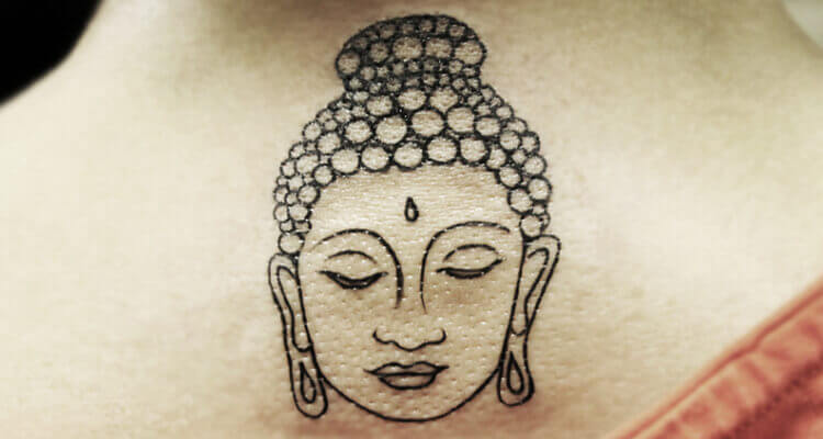 Small Buddha Face tattoo on Back
