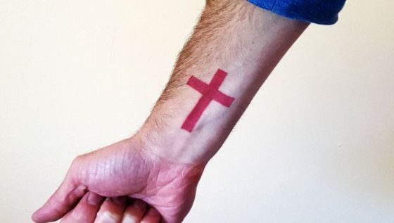 Small Red Cross Tattoo on wrist 19