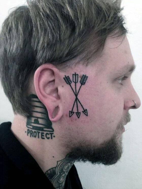 Arrow tattoo design on face