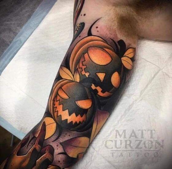 Ghoulish Pumpkin Halloween tattoo on arm