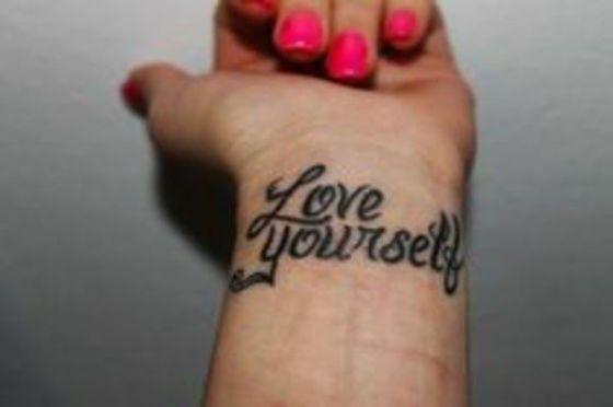 Wrist quote tattoo