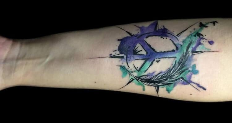 Peace Sign tattoo on arm 1