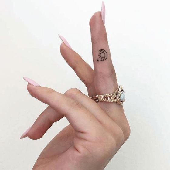 Tiny finger tattoo