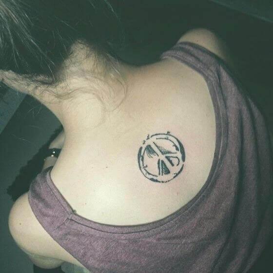 peace sign tattoo on back