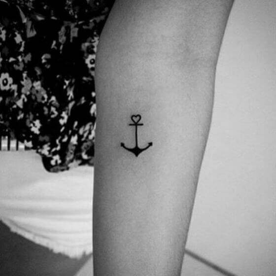 Anchor with Heart Tattoo on female arm 2