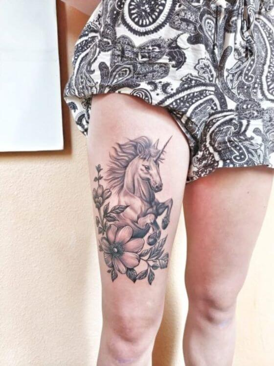 best Unicorn with Flowers tattoo on girl thigh