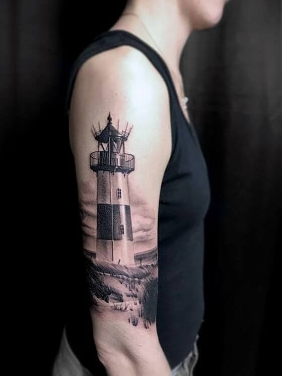 lighthouse tattoo on man shoulder