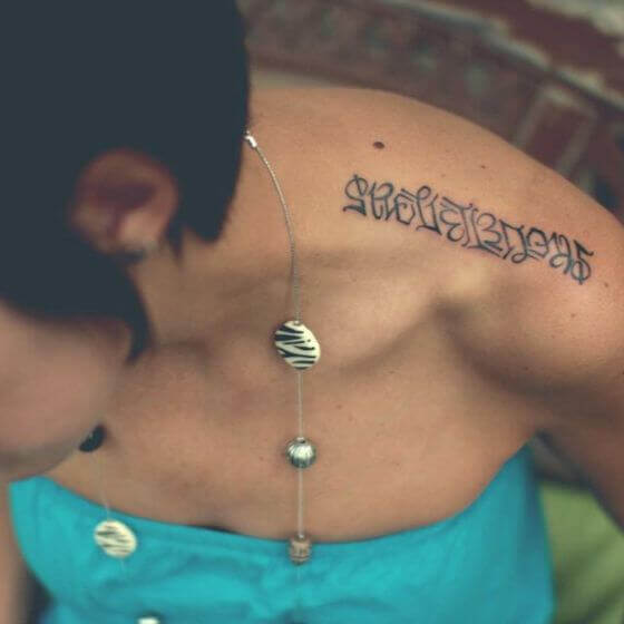 Ambigram shoulder tattoos