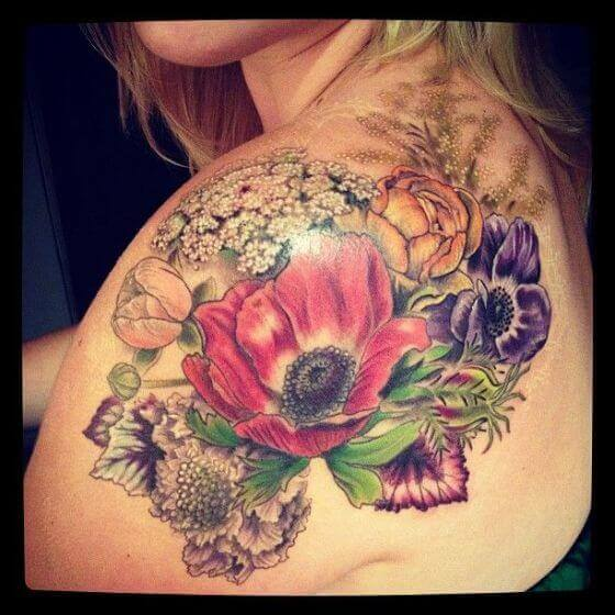 Colorful Flowers tattoo on girl shoulder