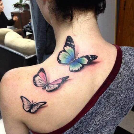 Three Butterflies shoulder tattoo female