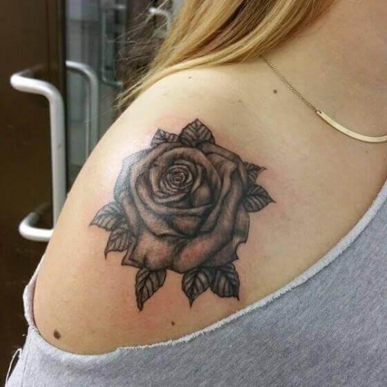 female Black rose tattoo on shoulder