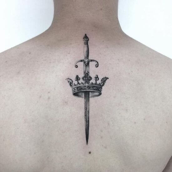 Small Sword Crown tattoo on back